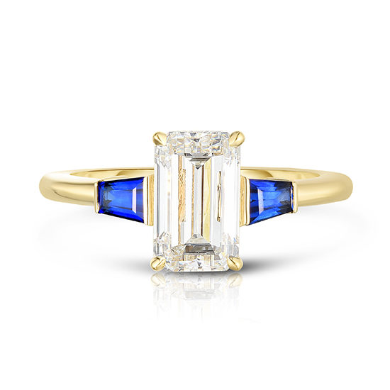 The Emerald Cut Three Stone Ring with Blue Sapphire Tapered Baguettes
