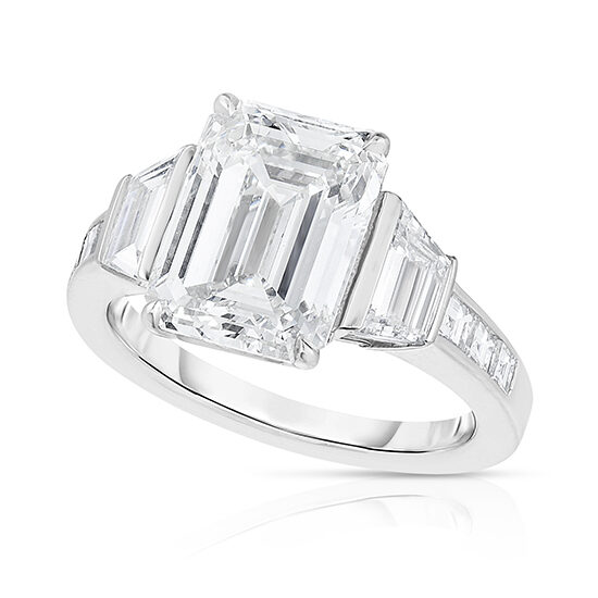 Three Stone Emerald Cut Diamond Engagement Ring With Trapezoid side stones and channel set Princess Cut Diamonds
